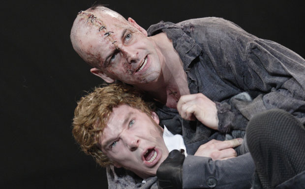 FRANKENSTEIN, National Theatre 2011, directed by Danny Boyle JONNY LEE MILLER as The Creature, BENEDICT CUMBERBATCH as Victor Frankenstein. Photo by Catherine Ashmore